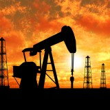 Crude Oil Slides as US Adds to Output