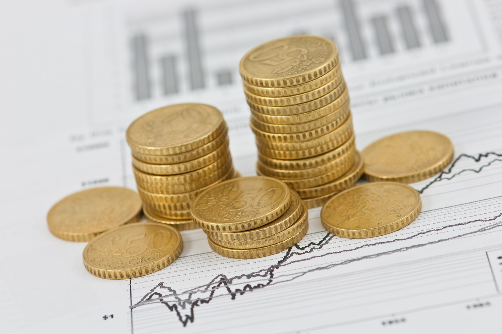 gold coin graph on the business document